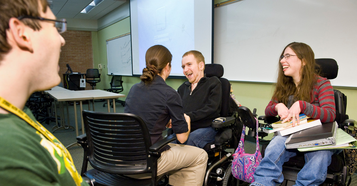 Image of workers with clients with disabilities