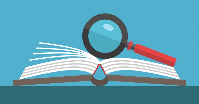 Magnifying glass resting on an open book