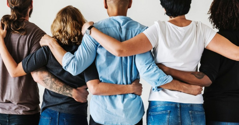 Diverse group linking arms together