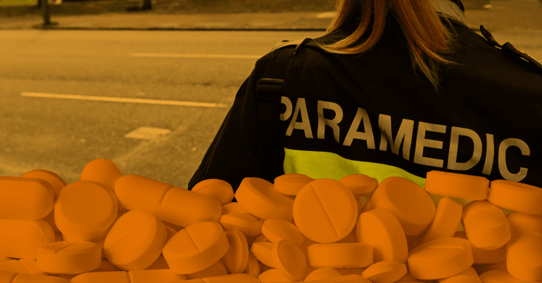 A woman wearing a paramedic jacket is facing away from the camera. A translucent image of pills is superimposed.