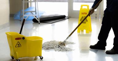 Custodian mopping school floors