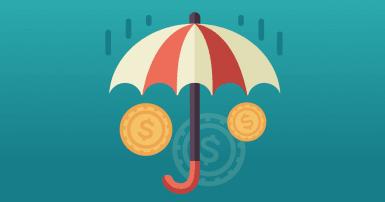 Un parapluie rouge et blanc protège des pièces de monnaie de la pluie