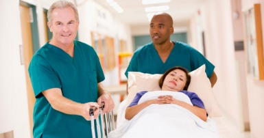 Hospital orderlies with patient