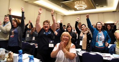 HEU convention delegates react to live-streamed announcement that punitive health worker legislation will finally be repealed.