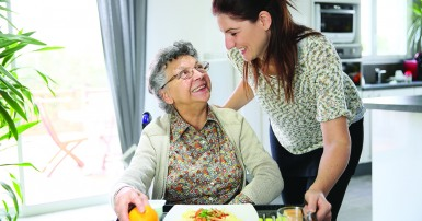 Home support worker and patient at breakfast