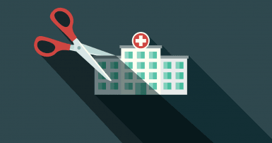 Simple illustration of a hospital building with giant scissors poised to cut it in half