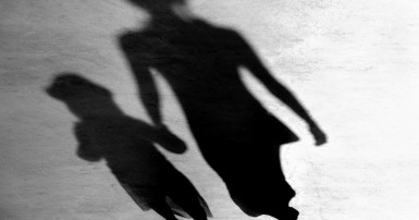 Shadow of woman and girl holding hands