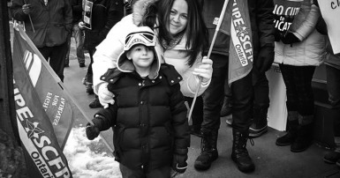 CUPE member and young child rally for education