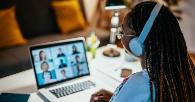 Woman with headphones in a meeting