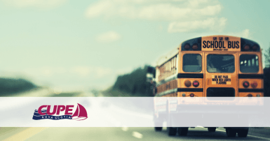 Web banner. No text. Image of school bus on a highway, with the CUPE Nova Scotia