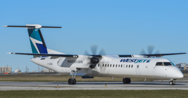 Westjet Encore plane on the runway