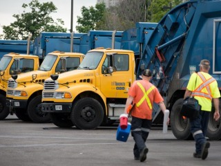 Toronto solid waste removal trucks and workers