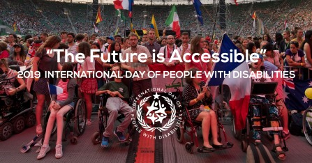"Image of a large group of people in a stadium, some of whom are using wheelchairs and/or holding international flags. Text says 2019 IDPWD ""The Future is Accessible"""