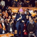 NDP Leader Jagmeet Singh in the centre of a large rally with a Quebec flag as a backdrop