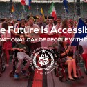 """Image of a large group of people in a stadium, some of whom are using wheelchairs and/or holding international flags. Text says 2019 IDPWD """"The Future is Accessible"""""""