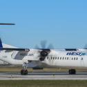 Westjet Encore plane on the runway