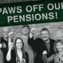 Black and white photo of a group of 10 people with their fists raised and a green banner above that says Paws off our pension