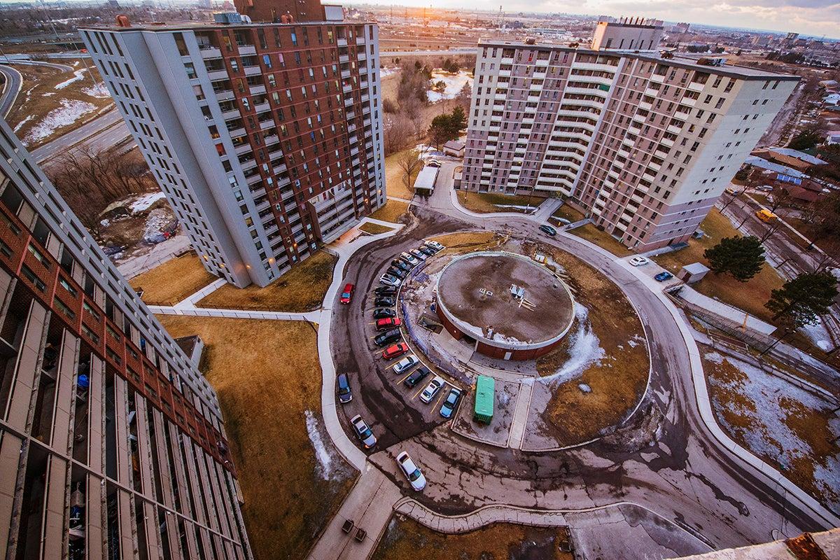 Three high rise apartment buildings and a circular driveway